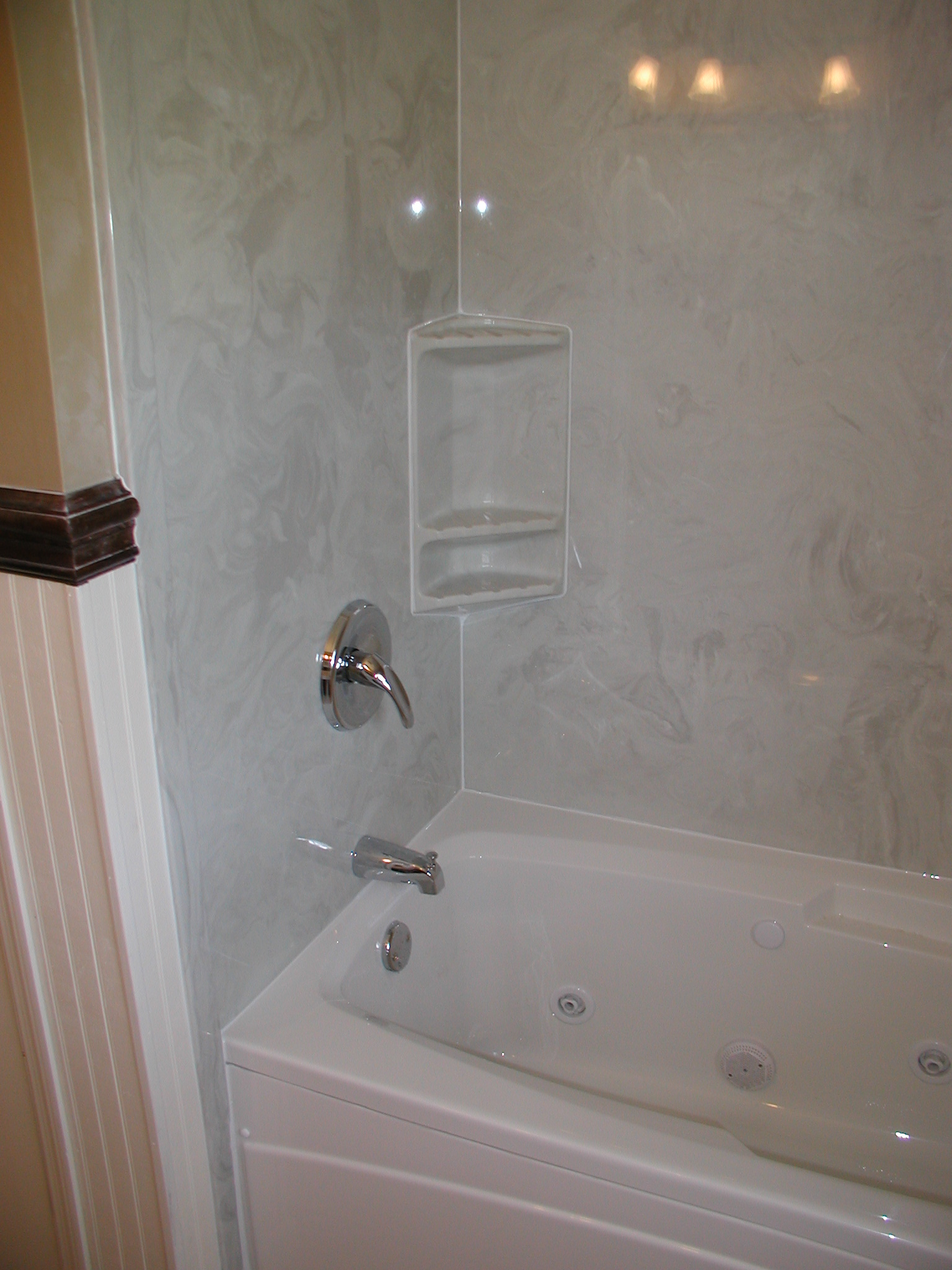 Can you apply ceramic tile over a plastic tub surround? What about